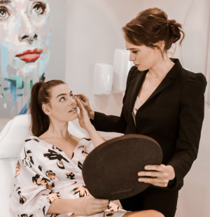 female client having in-clinic consultation with Dr Marisa Heyns for a scalp & hair wellness consultation